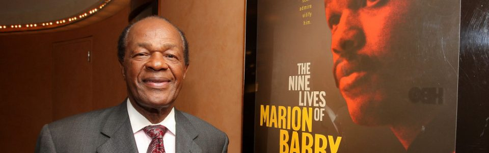 Marion Barry, former mayor of DC, posing next to a poster for the documentary on his life: The Nice Lives of Marion Barry. Flavorlab provided original score and mix for the film.