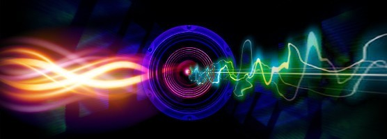 Image of orange and pink waves flowing through a speaker face and flowing out the other side as a green sound wave. Flavorlab is offering free sound effects.