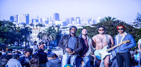 Picture of band, Vinyl Spectrum, standing in front of the Los Angeles skyline. Vinyl Spectrum is a producer for the Producer's Toolbox.
