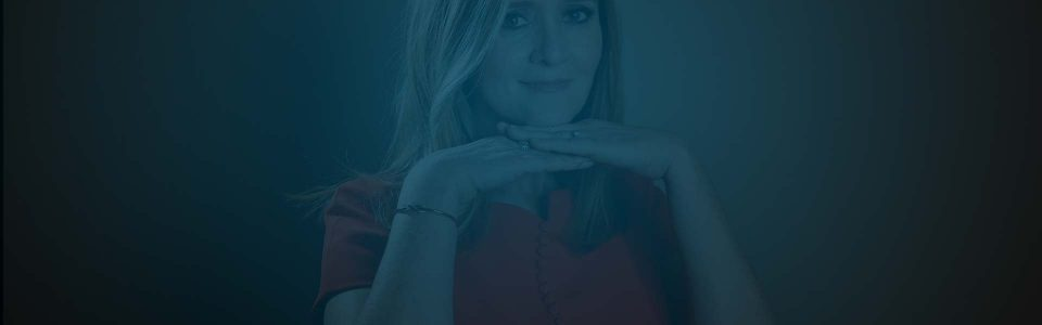 Still of Samantha Bee with her hands crossed beneath her chin. Flavorlab Score provided custom original music for the show.