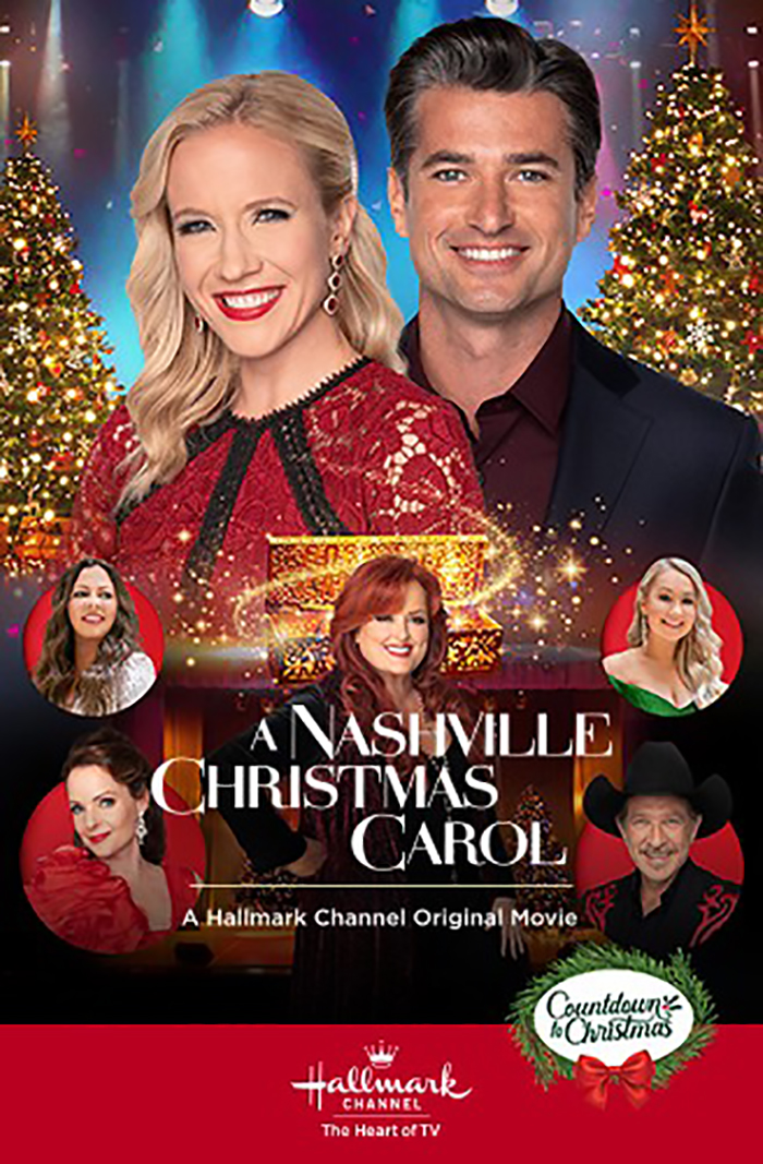 """Movie poster for Hallmark's A Nashville Christmas Carol. The poster features Jessy Schram in a red lace dress with black diagonal lines on the chest standing next to Wes Brown in a maroon shirt and black coat jacket, smiling at the camera in front of a concert stage and two ornate Christmas trees. The image is overlaid with images of the film's cameos: Wynonna Judd, Kix Brooks, Kimberly Williams-Paisley, Sarah Borne, and Sara Evans. Winnona Judd is overlaid with the title """"A Nashville Christmas Carol 