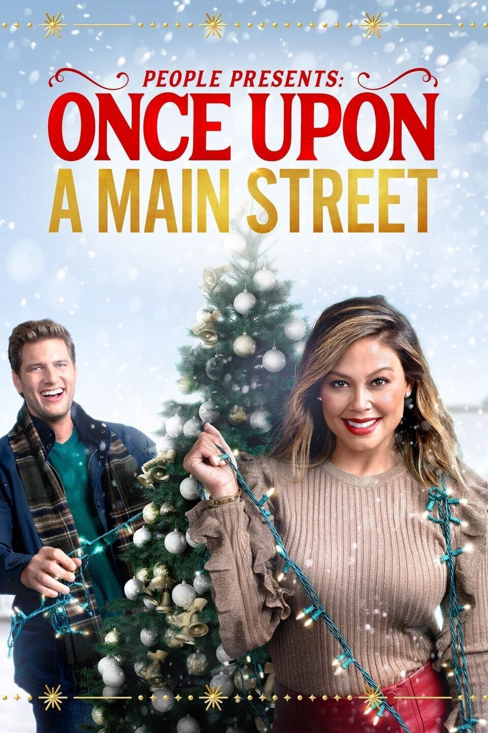 """Movie poster for People's Once Upon a Mainstream on Lifetime, released November 29th, 2020. The poster features Vanessa Lachey in a beige ribbed sweater, red pants, and red lipstick in the foreground holding white tree lights with Ryan McPartlin in a green shirt, blue jacket, and striped scarf holding the same strand of lights in the background. The are standing in front of a Christmas tree with silver and gold ornaments outside and it's snowing. The image is overlaid with the words """"People Presents: Once Upon A Main Street."""" Flavorlab Sound provided full service audio post production for the film."""