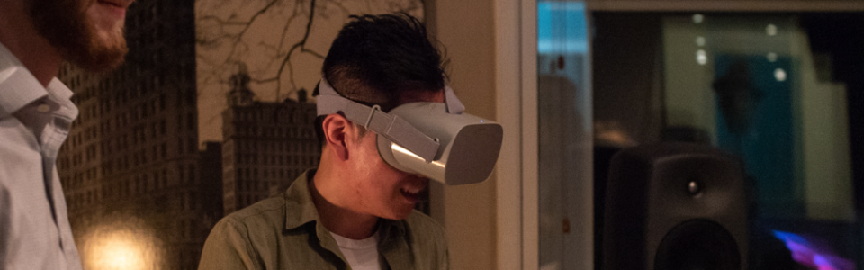 JC Chao wearing a VR headset at the Flavorlab 360 showcase with Gramercy Tech