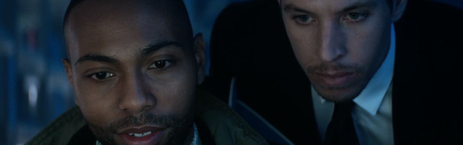Still of Beau Knapp & Jeremie Harris staring at a computer screen in 2019 film Crypto. Flavorlab Sound provided complete audio post production - sound design, voice over recording, and mix to the feature.