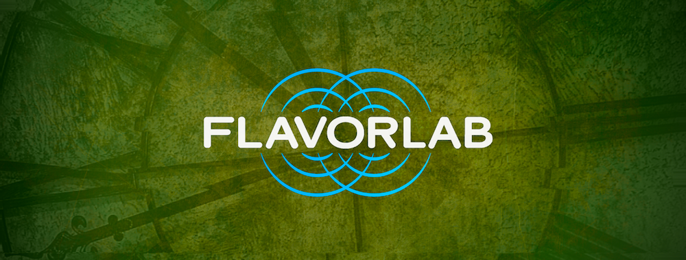 Banner for the 2021 March Tastes playlist - the Flavorlab logo overlaid on a distorted, green picture of a wrought iron clock.