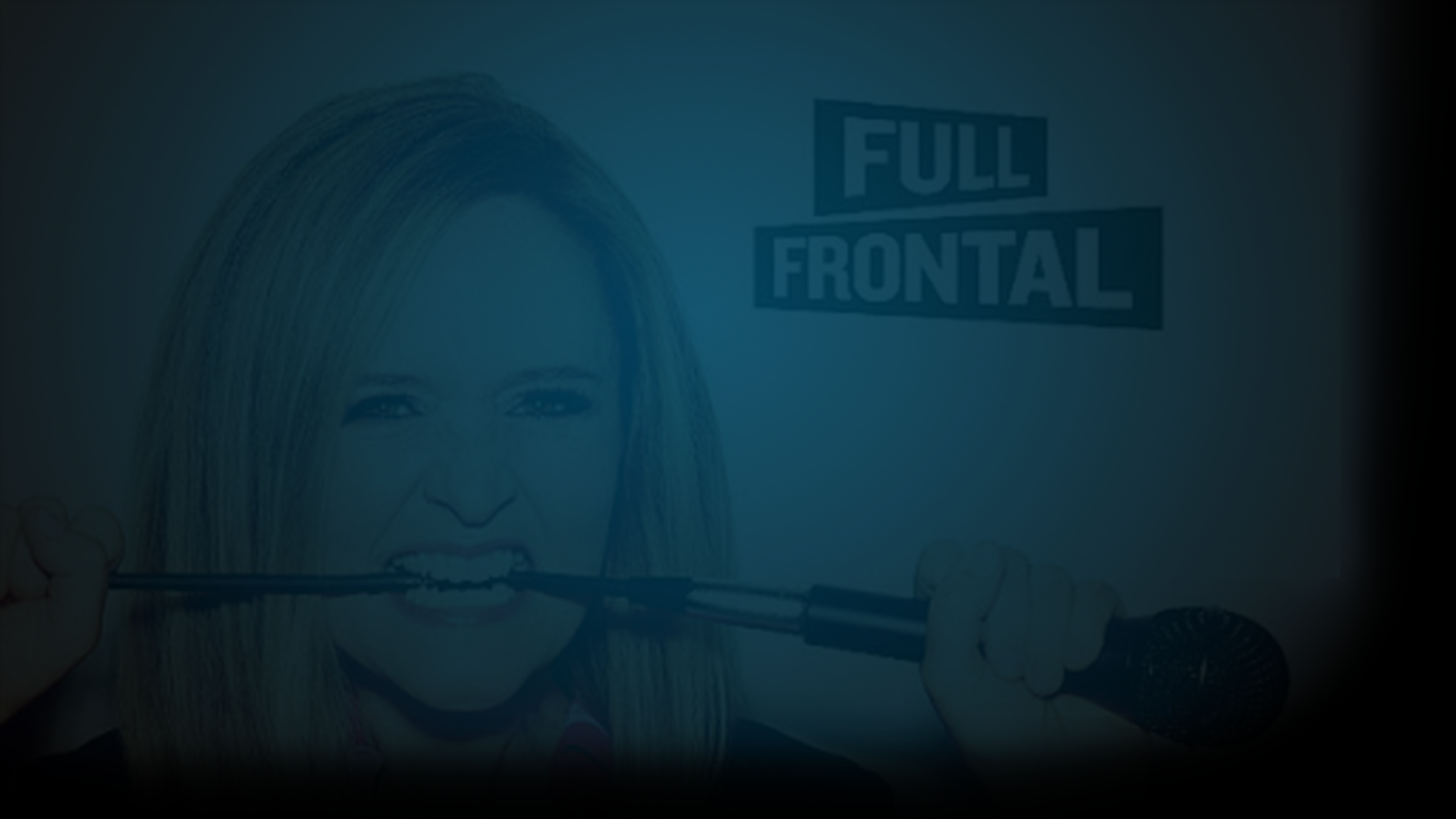 "Still of Samanatha Bee biting the cord of a microphone as she looks into the camera. The words Full Frontal are next to her head. Flavorlab Score provided original music to the show with song ""Working Man."""