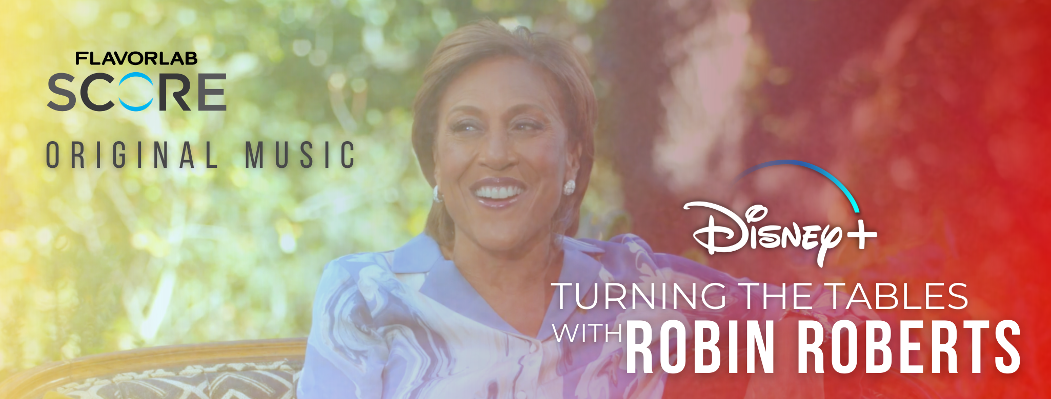 """Still of Robin Roberts smiling on an outdoor couch on Turning Tables with Robin Roberts on Disney Plus. The image is overlaid with red and yellow gradient with the words """"Flavorlab Score Original Music"""" in the top left and """"Disney+ Turning The Tables with Robin Roberts"""" in the bottom right. Flavorlab Score provided original score for the series available July 28th 2021."""